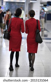 Airport Departures Terminal, HongKong-18July2021:last day of LOTR Leave Outside the Rules, Airline stewardess, flight attendant ,Cabin Crew with mask on face and red uniform, working in busy schedule