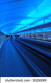 Airport Escalator in blue light at night