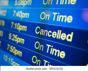 Airport flight cancelled. Airport arrival and departure monitor sign showing on-time and cancelled flight status