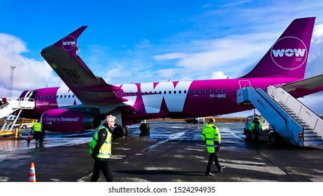 Reykjavík Airport, Reykjavík, Iceland - March 23, 2018: leaving wow air aircraft using stairs after landing on Reykjavík with staff wearing safety vest working in the front