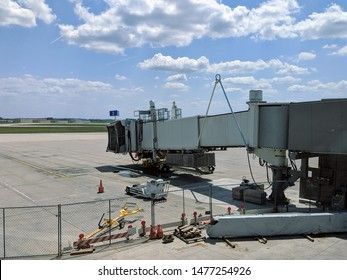 Airport jet bridge waiting for an arriving airplane