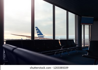 Airport lounge with background view of airplane through window