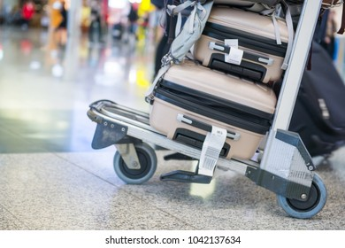 Airport luggage trolley with suitcases, travel