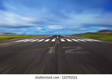 Airport Runway During a Takeoff