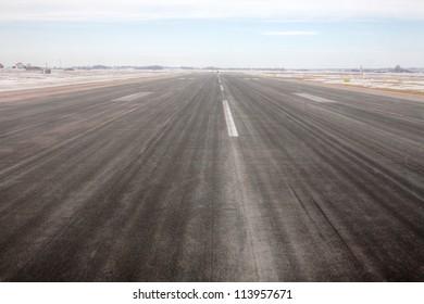 An Airport runway during winter