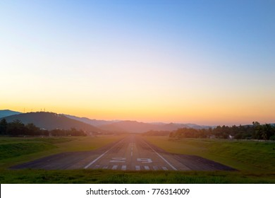 Airport runway in the evening sunset light.