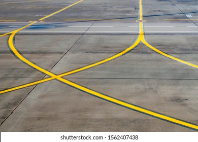 Airport runway, a part of road with yellow signal lines for aircraft, selective focus