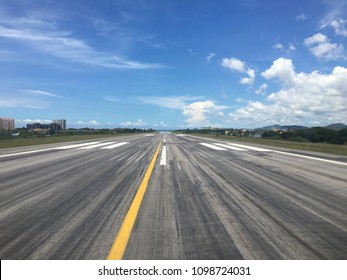 Airport runway range from pilot view in aircraft cockpit line up for take off with sea and blue sky background and copy space