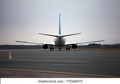 Airport scene. Plane Parking. Close-up.