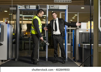Airport security check at gates with metal detector and scanner