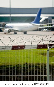 Airport security, razor wire soft focus view