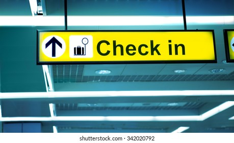 Airport Sign Pointing to Check-in Area,