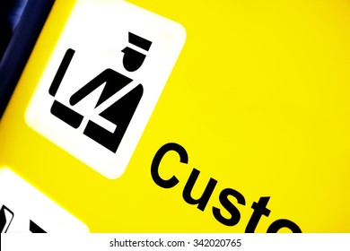 Airport Sign Pointing to Customs Control Area