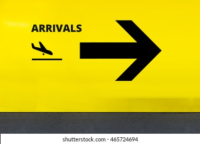 Airport Sign With Prayer room Icon and Arrow on Yellow Wall