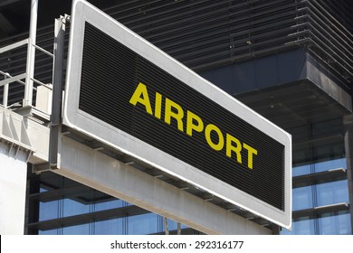Airport signpost in the city with building facade background. Horizontal