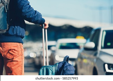 Airport taxi. Passenger is waiting for taxi car.