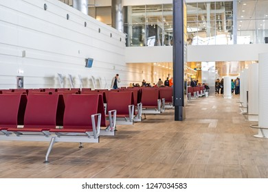 Airport terminal empty seats people on background