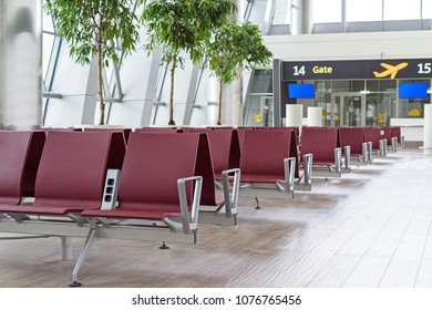 Airport terminal, empty waiting chairs near gate