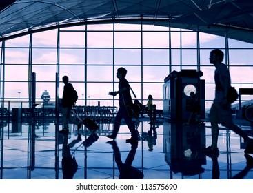 Airport terminal hall. Walking travelers