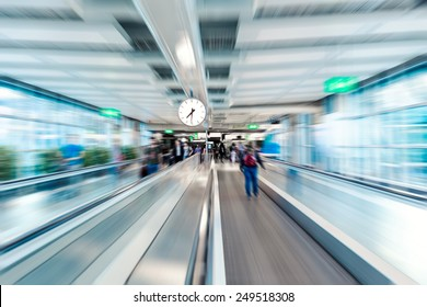 Airport terminal interior, moving walkway. Motion blur effect.