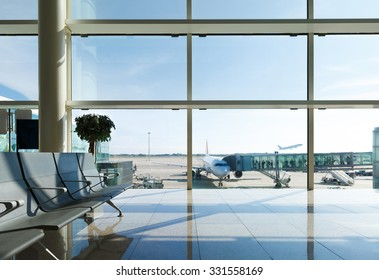 Airport terminal, people going to airplane in background