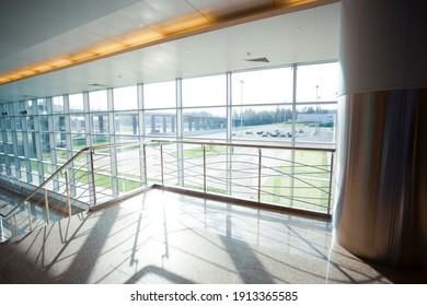 Airport terminal or shopping mall interior with windows. Nobody