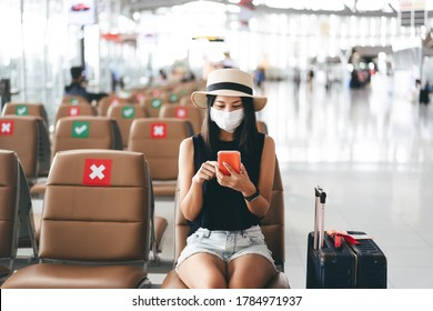 Airport terminal social distancing chair form corona virus pandemic. Young adult tourist woman sitting wear mask protect from covid 19. People travel with new normal lifestyle concept. - Shutterstock ID 1784971937