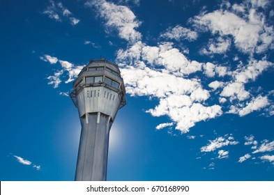Airport traffic control tower with background of the sky and clouds