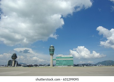Airport traffic control tower at Hong Kong International Airport on a clear sunny day