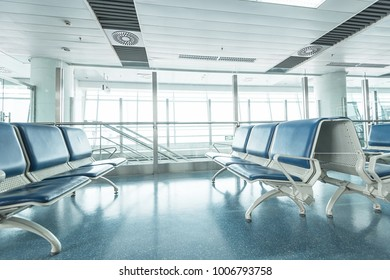 airport waiting area , seats and outside the window scene