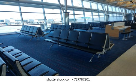 airport waiting rooms, lounges with glass windows, chairs and airplanes  jfk