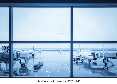 airport window view with blue tone on a rainy day