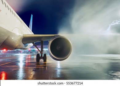 Airport in winter. Deicing of the airplane before flight.