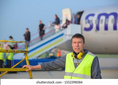 airport worker arrival landing runway outside male