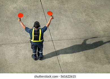 Airport worker directing