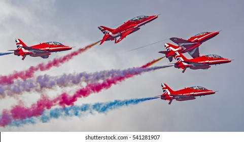 Airshow - JUNE 2016 - RAF Red Arrows displaying over Torbay. Crossing over each other. (editorial)