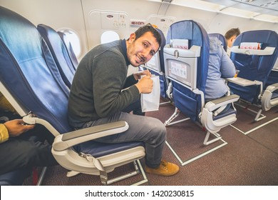 airsickness in the airplane, man passenger afraid and feeling bad during the flight in plane