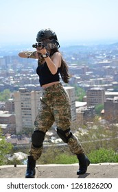 Airsoft game beautiful Girl With Gun. Nice and danger