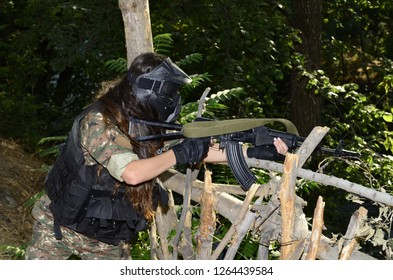 Airsoft game beautiful Girl With Gun. in forest