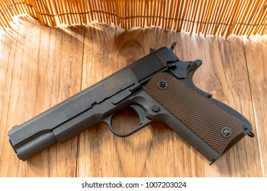 airsoft guns are placed on brown wooden floors and bamboo scenes are taken with natural light