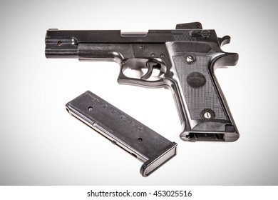 Airsoft hand gun isolated on white