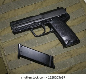 Airsoft hand gun USP P8 and its magazine (Moscow, Russia) - November 13, 2018