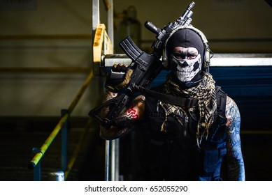 airsoft masked soldier in uniform woth weapon and equipment