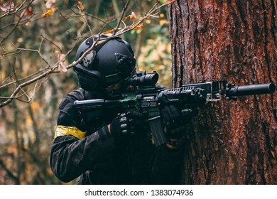 the airsoft military man with a gun in action
