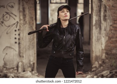 airsoft woman soldier with a rifle playing strikeball In an abandoned old building