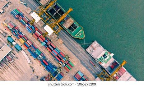 Airspace view from fly drone of shipping and freight import of goods and freight export and delivery to the internationanl port. Water transport concept.