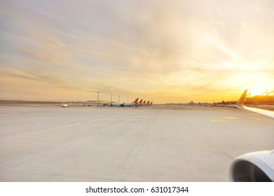 airstrip for airplanes in the airport in sunset light