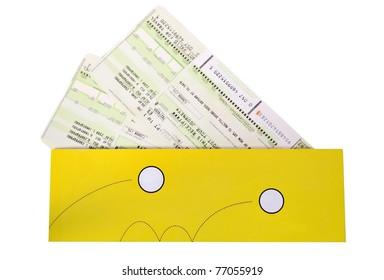 Airtickets to yellow envelope on white background