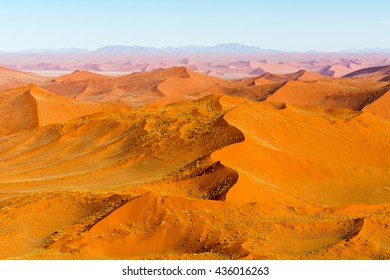 Airwiew of the dunes and sourounding region of the Sossusvlei. Here you find the worlds highes sand dunes. Located in Namib Naukluft Park, Namibia, Africa.