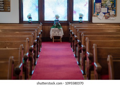 Aisle between the pews in a small church - landscape